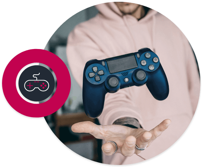Picture in a circle of man in hoodie with with a video game controller above his hand